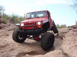 muddy jeep kmc xd addict and nitto mud grapplers on a jeep wrangler