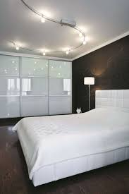 track lighting for bedroom minimalist modern bedroom with track lighting fixtures over the