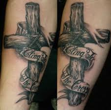 cross banner tattoo on biceps for guys photos pictures and