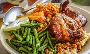 traditional cuisine of sur chicken with rice and kouseband jpg itok gdpwxszc