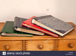 photograph albums a pile of family photograph albums on top of a chest of