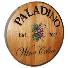 personalized reclaimed wine barrel head with wine cellar and