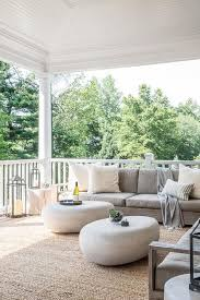 pebble outdoor coffee table modern covered patio features a low armless outdoor sofa lined with