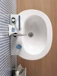 Bathroom Sink Makes Gurgling Noise - kitchen sink drain water draining flowing swirling blue