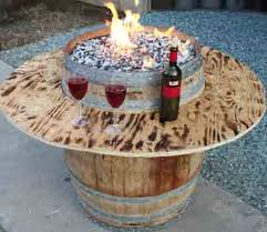 homemade fire pit table diy fire pit table from a wine barrel diy outside pinterest