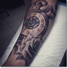 wonderful simple gear pocket watch with rose tattoo design idea