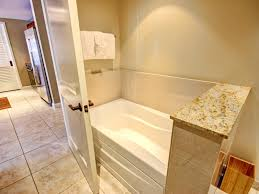 kbm hawaii honua kai hkk 445 luxury vacation rental at separate bathtub in the guest bathroom with access from living room and the bedroom