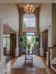 outstanding foyer decorating with floral wall art and luxurious
