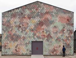 so hot right now scale shingles in architecture design handmade concrete tiles provide a textured scaly facade for this collaborative workplace designed by assemble for artists and designers in east london