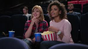 cinema entertainment and people concept happy friends watching