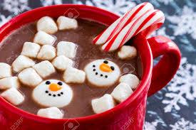 snowman marshmallows mug filled with hot chocolate with snowman marshmallows