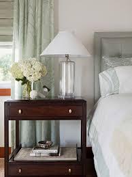 elegant tufted headboard crisp white bedding with gray green