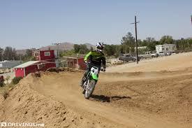how to ride a motocross bike kawasaki shows us how to ride dirt bikes drivingline