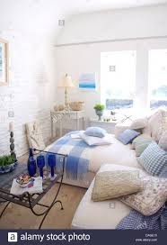 Coastal Cottage Living Rooms by Cushions On White Sofa In White Coastal Cottage Living Room With