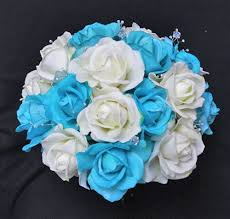 white and blue roses touch aruba turquoise blue bouquet