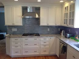 super white quartzite countertop cabinets by ted wood in frosty