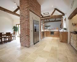 Photo Of Elegant Matt Cream Exposed Brick Red Brick Crown Tiles - Dining room tile