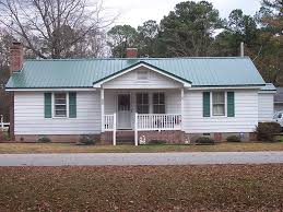 green metal roof gray house popular roof 2017