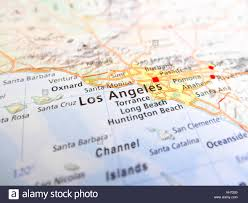 Usa Road Map by Los Angeles City Over A Road Map Usa Stock Photo Royalty Free