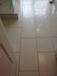 12x24 off white tile with carrara marble oval penny tile inlay