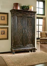 living room armoire scrolling gate armoire mediterranean living room dallas by