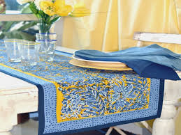 blue linen table runner and another blue and green table runner