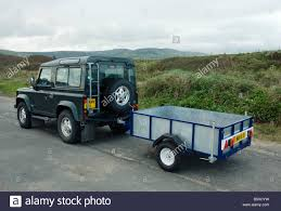 land rover small land rover defender with small trailer stock photo royalty free