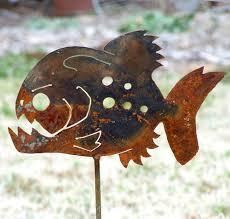 metal flower garden stakes piranha garden stake garden fish sculpture frenzy