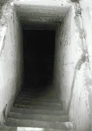 Looking Down Stairs by View Looking Down Into The Cellar Coffin Of The Death Pit The