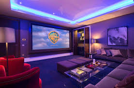 high end home theater projector movie room with giant pillows and movie projector description