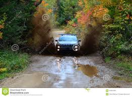 jeep water jeep cherokee trailhawk 4x4 offroad coming through waterhole