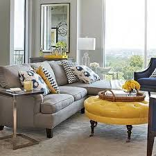 a navy accent wall cream curtains grayish brown couch accents