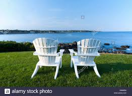 Chairs On A Beach Two White Adirondack Chairs On A Lawn Overlooking The Atlantic