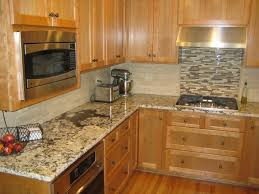 beige tile backsplash connected by brown wooden counter with beige