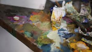 artist mixes paint on the palette art brush mixed paint on the