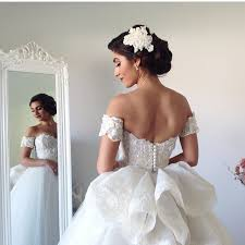 the gown and hair ornamentation brides gowns