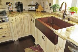 timeless copper kitchen sink installed in the kitchen over wooden