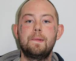 photo of teardrop tattooed man wanted after acid attack on