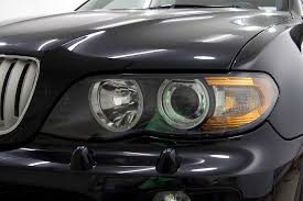 bmw x5 headlights hologram removal on a black 2006 bmw x5 rasky s auto detailing