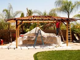 two piece bbq island w solid roof palapa extreme backyard designs