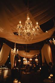 Candle Lit Chandelier Sheer Drapes And Chandelier Candlelight Reception Decor