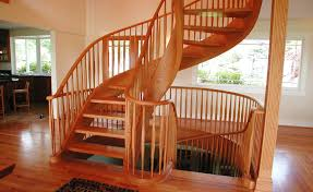 hand crafted graceful red oak two story tight spiral stair by