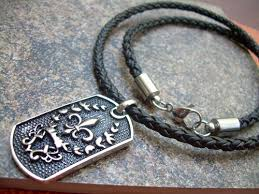 braided leather necklace images Stainless steel fleur de lis pendant on a braided leather necklace jpg
