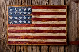 wooden american flag on wood wall photograph by garry