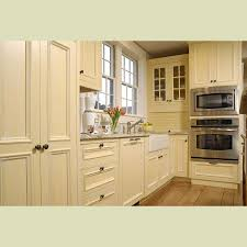 Cream Colored Kitchen Cabinets With White Appliances by Cabinet Cream Childcarepartnerships Org