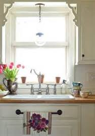 kitchen sink lighting ideas kitchen sink lighting home design ideas and pictures