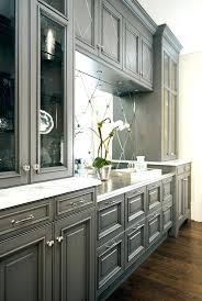 Cream Color Kitchen Cabinets Love This Grey Cabinetry And Antique Mirror Backsplashantique