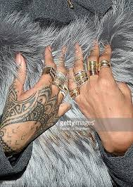 rihanna hand tattoo stock photos and pictures getty images