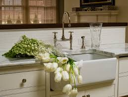 lovely kitchen with ivory kitchen cabinets marble countertops