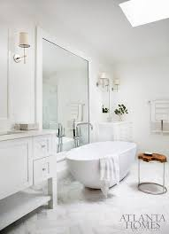 White Framed Mirror For Bathroom Egg Shaped Tub In Front Of White Framed Wall Mirror Transitional